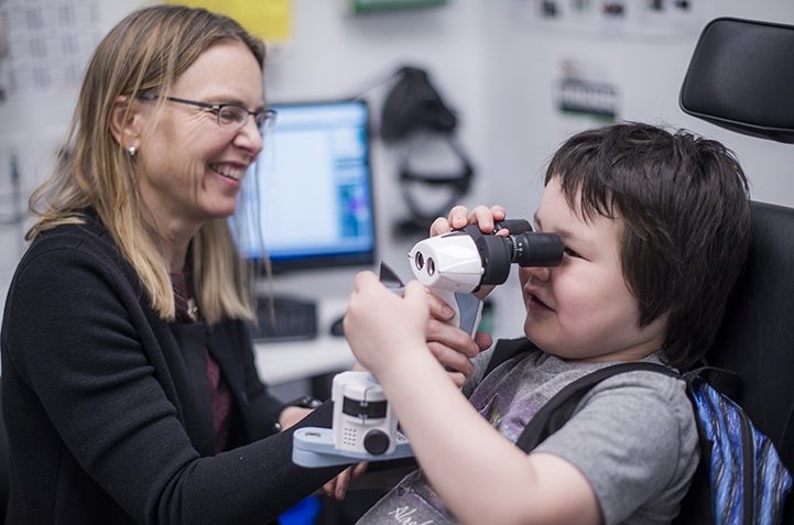 Pediatric ophthalmologist Dr. Jane Gardiner sees a patient at the DEEC.